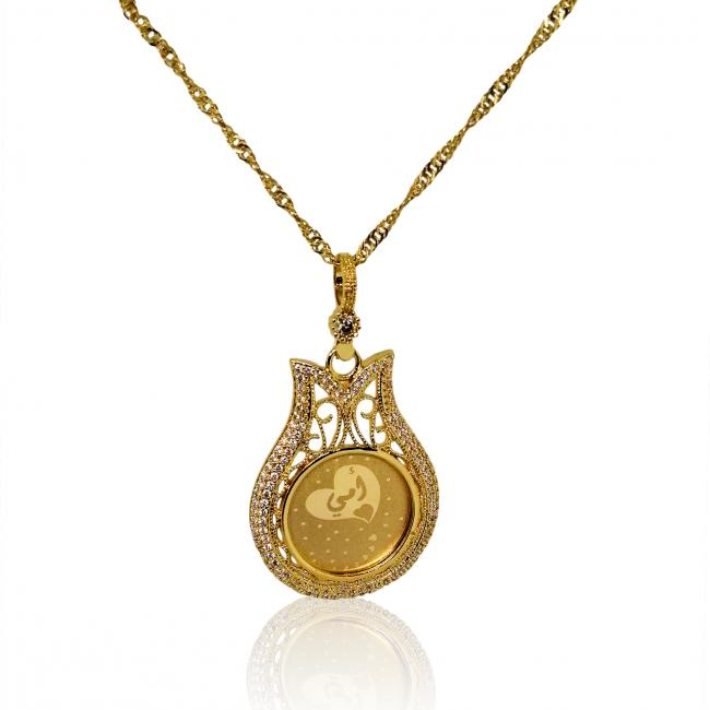 Gold-color necklace engraved with the word 'mom in Arabic